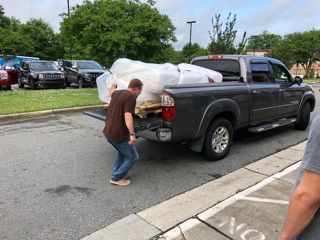 Charlotte plumbers delivering beds for Beds=Dreams Ministry